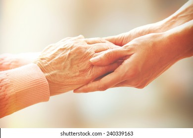 Helping hands, care for the elderly concept - Shutterstock ID 240339163