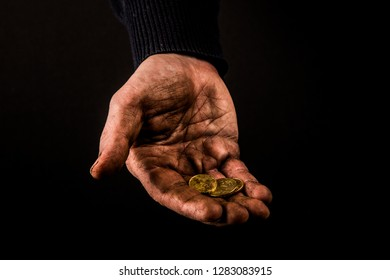 Helping hands concept, Man's hands palms up holding money coins, need care and support, reaching out, dirty hands