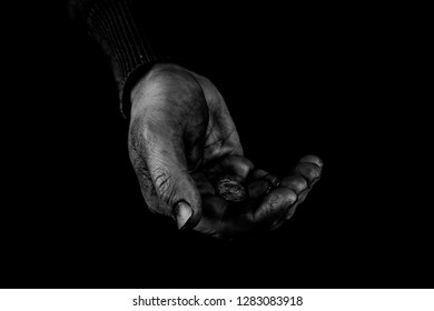 Helping hands concept, Old Man's hands palms up holding money coins, need care and support, reaching out, black and white