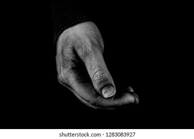 Helping hands concept, Poor Man's hand holding something, need care and support, poor man, black and white