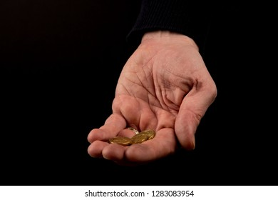 Helping hands concept, Rich giving the poor, Man's hands palms up holding money coins, reaching out, color