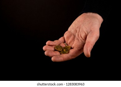 Helping hands concept, Rich giving the poor, Man's hands palms up holding money coins, reaching out, showing compassion