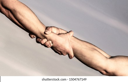 Helping hands concept, support. Close up help arm. Helping hand concept and international day of peace, support. Two hands, helping arm of a friend, teamwork.