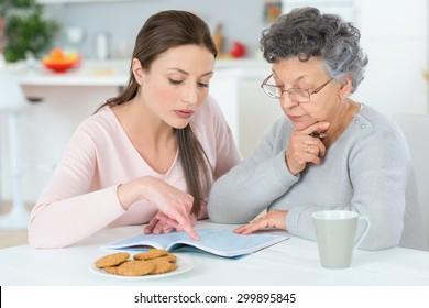 Helping her grandma do a crossword