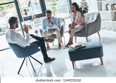 Helping to save marriage. Young married couple talking while sitting on the therapy session with psychologist