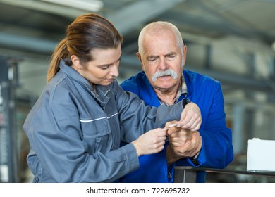 helping senior colleague with a finger accident