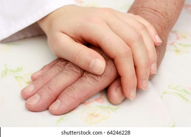 Helping the senior, holding hand