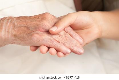 Helping the senior, holding hand