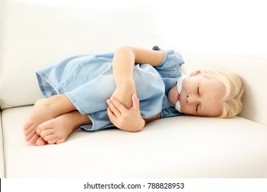 Helpless little girl lying with gag in mouth. Child abuse concept