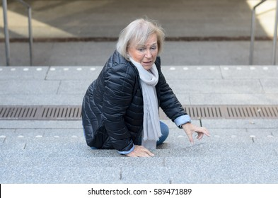 Helpless senior woman falling down steps and looking irritated