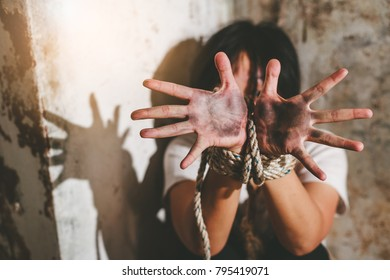 Helpless young woman hands tied with rope, Missing kidnapped, Hostage, human trafficking and violence concept