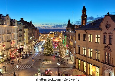 HELSINGBORG, SWEDEN - DECEMBER 11, 2015: Evening view of Stortorget Square with Christmas Tree, Tower of the City Hall, Oresund strait and Danish coast. The square was built in 1693.