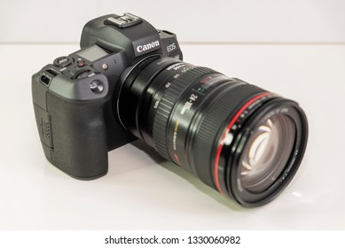 HELSINGBORG, SWEDEN; March 1, 2019: The new mirroless full frame camera Canon EOS R, with the mount adapter and EF 24-105 mm lens attached.