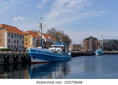 Helsingor, Denmark - April 28, 2018: Two blue fishing boats anchored in the port harbor