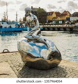 "HELSINGOR, DENMARK; MARCH 24, 2019. Statue called ""HAN"" in the harbor, created by artist team Elmgreen Dragset."
