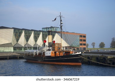 """HELSINGOR, DENMARK - NOVEMBER 02, 2014: Old tugboat moored in the harbor of the community center """"Culture Yard '. Helsingor, Denmark"""