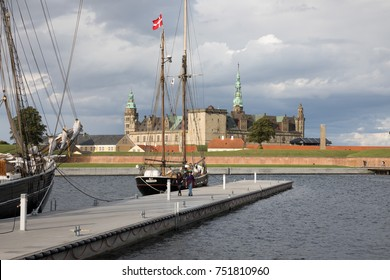 HELSINGOR, ZEALAND, DENMARK - AUGUST 19, 2107: Tall ship at Tall Ships Festival in harbour with Kronborg Castle used as setting for Shakespeare's Hamlet in distance