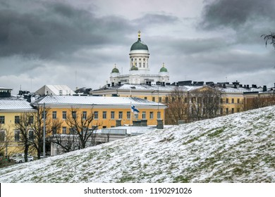 Helsinki Cathedral rises above historic government buildings in downtown Helsinki on a cold winter day - Helsinki, Finland