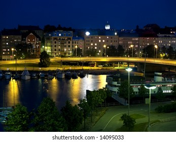 Helsinki downtown in night illuminated by streetlights