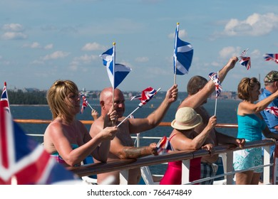 Helsinki Finalnd; 27th July 2016; British Holidaymakers Waving Union Jack and Saltire Flags at Sailaway Party on Cruise Ship Leaving Harbour