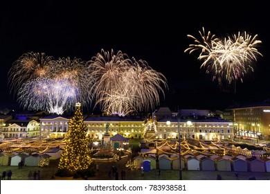 HELSINKI, FINLAND - 06 DECEMBER, 2017: Independence day fireworks above christmas market in Helsinki, Finland on December 06, 2017