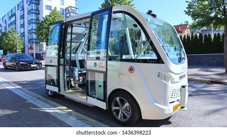 Helsinki, Finland -06-28-2019: Robot bus or driverless bus on its route in Southern Helsinki. Autonomous bus drives along its route like a lift. It scans its surroundings  and knows when to slow down.