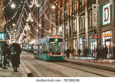 HELSINKI, FINLAND - 24 December 2017: Helsinki tram on Christmas street