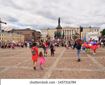Helsinki, Finland. 29 June 2019 - People celebrating Helsinki Pride 2019 with rainbow symbols. Helsinki Pride is the biggest cultural and human rights event for gender and sexual minorities in Finland