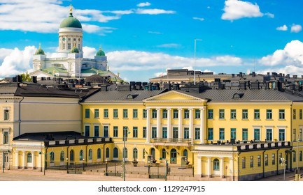 Helsinki, Finland 7.7.2018 Presidentinlinna the Presidential Imperial Palace and behind Helsinki Cathedral towers.  Palace is official residences in Helsinki of President of Republic of Finland.