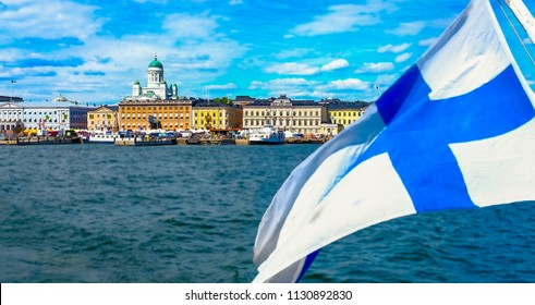 Helsinki, Finland 8.6.2018  The Finnish flag is floating. Market Square and Helsinki Cathedral from the sea. The seascape of Helsinki in the summer.