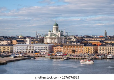 Helsinki, Finland - April 14 : Cathedral and other city buildings with central cityscape in Helsinki on April 14, 2019. With beautiful evening light.