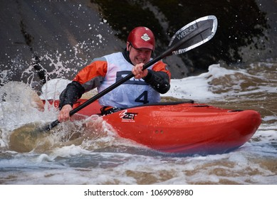 Helsinki, Finland -  April 15, 2018: Unidentified racer at the annual Icebreak 2018 whitewater kayaking competition at the Vanhankaupunginkoski rapids in Helsinki, Finland.