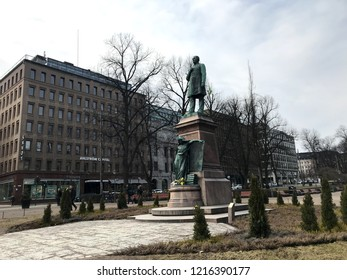 Helsinki, Finland - April 15, 2018: The Esplanadi Park, A very nice park in the heart of Helsinki, with a statue of Finland's national poet, Johan Ludvig Runeberg, in the center.