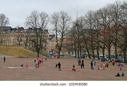 Helsinki, Finland - April 3, 2017: children are playing outdoor in Helsinki Finland