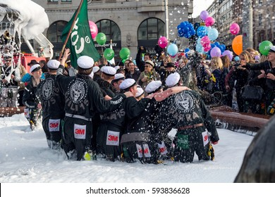 HELSINKI, FINLAND - APRIL 30, 2015. Vappu May Day Labor Day celebration. The Havis Amanda fountain statue is washed by university students.