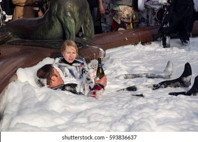 HELSINKI, FINLAND - APRIL 30, 2015. Vappu or May Day Labor Day eve.  Students partying in the Havis Amanda fountain and drinking sparkling wine or champagne.