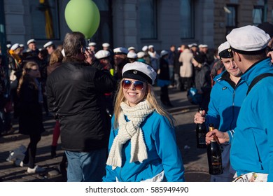 HELSINKI, FINLAND - APRIL 30,2013. May Day Labour day feast. Students wearing a traditional white cap and celebrating with champagne and sparkling wine