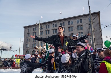 HELSINKI, FINLAND - APRIL 30,2015. May Day Labor Day celebration. Students wearing traditional white student caps, or ylioppilaslakki, and celebrating event around the fountain statue of Havis Amanda