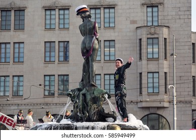 HELSINKI, FINLAND - APRIL 30,2015. May Day Labor day event. Student celebrating and going to swim at the fountain of Havis Amanda