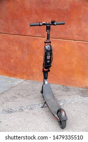Helsinki, Finland - Aug. 13, 2019: Electric rental scooter by Voi in downtown Helsinki, Finland, Aug, 2019. Scooters rentals with phone apps are a huge trend in Helsinki, Finland.