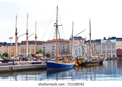 HELSINKI, FINLAND - AUG 28,2017 : Vintage wooden boat at North port Helsinki and colorful building in background. Summer in Finland. Europe
