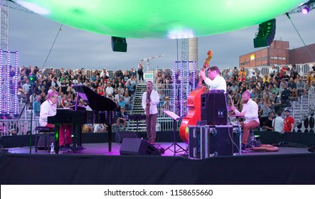 Helsinki, Finland - August 10, 2018:  Finnish Olli Ahvenlahti New Quartet performing live on Balloon 360 -stage at Flow 2018 Festival. Olli Ahvenlahti  is a Finnish pianist, composer and conductor.