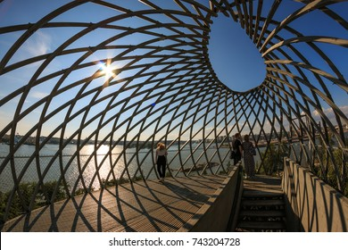 HELSINKI, FINLAND - AUGUST 10th 2017: A person looking at Helsinki cityscape out of web like view tower in Helsinki ZOO on a sunny summer day.