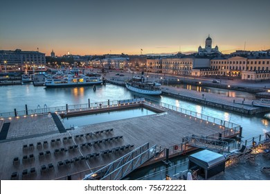 HELSINKI, FINLAND - AUGUST 10th 2017: Public pool and the main square and marina with the catedral in the backgroun, the symbols of the Helsinki city illuminated at dusk