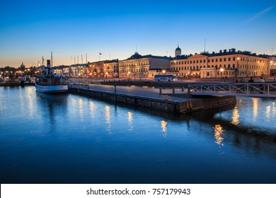 HELSINKI, FINLAND - AUGUST 10th 2017: The main square and marina with the catedral in the backgroun, the symbols of the Helsinki city illuminated at dusk