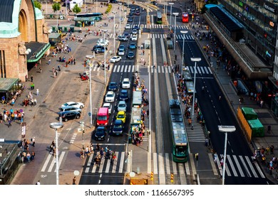 HELSINKI, FINLAND - AUGUST 11, 2018: City center of Helsinki the capital of Finland. People, car and tram traffic in front of the main railway station. Busy day in the city center
