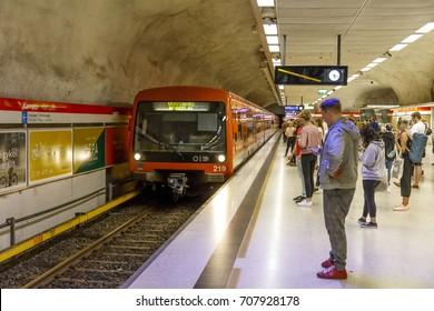 HELSINKI, FINLAND - AUGUST 13, 2017: People wait for the metro in Kamppi underground station in Helsinki, Finland on August 13, 2017