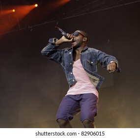 HELSINKI, FINLAND - AUGUST 14: British rapper Tinie Tempah performs on August 14, 2011 at On the Beach 2011 Concert  in Helsinki, Finland