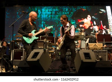 Helsinki, Finland - August 20,2018: Steve Vai performing with Finnish Marzi Nyman  and Tapiola Sinfonietta at Helsinki Festival 2018 in Huvila Festival Tent.