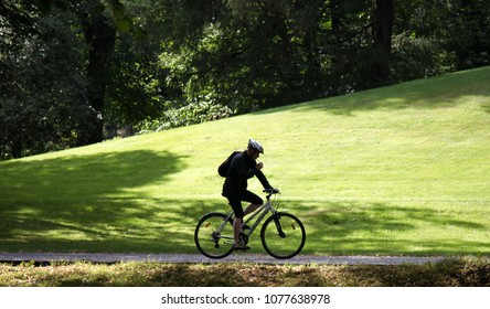 HELSINKI, FINLAND - AUGUST 22, 2017: Bike ride in Park. Cyclist on background of nature, cycle lane; criterium road
